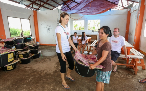 Distributing Relief Goods in the community center after Typhoon Haiyan in November 2013
